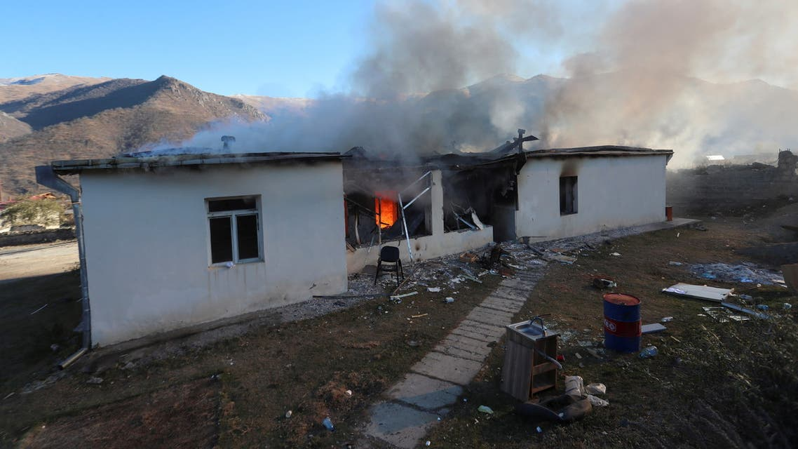 A view shows a house on fire in Karvatchar town in the region of Nagorno-Karabakh, November 24, 2020. The recent signing of a ceasefire deal ended a military conflict between Azerbaijan's troops and ethnic Armenian forces in the region. Picture taken November 24, 2020. Hayk Baghdasaryan/Photolure via REUTERS ATTENTION EDITORS - THIS IMAGE HAS BEEN SUPPLIED BY A THIRD PARTY