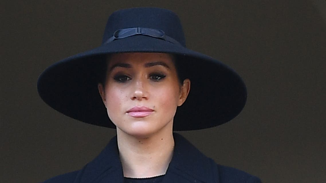 (FILES) In this file photo taken on November 10, 2019 Britain's Meghan, Duchess of Sussex looks on from a balcony as she attends the Remembrance Sunday ceremony at the Cenotaph on Whitehall in central London, on November 10, 2019. Meghan Markle has revealed she suffered a miscarriage in July this year, writing in the New York Times on November 25, 2020 of the deep grief and loss she endured with her husband Prince Harry.