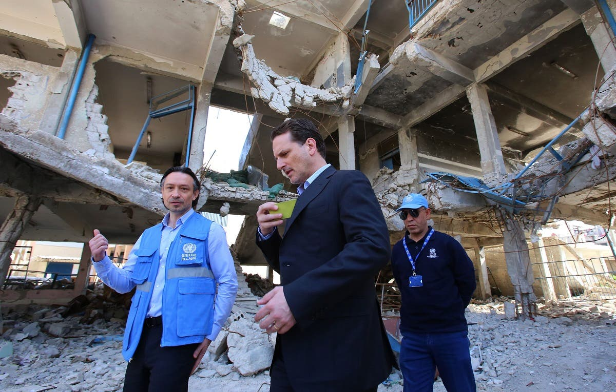Pierre Krahenbuhl (C), Commissioner-General for the for the United Nations Relief and Works Agency for Palestine Refugees in the Near East (UNRWA) visits a damaged UNRWA school in Sit-Zeinab, a southern suburb of the Syrian capital, Damascus, on March 10, 2015. (AFP/Youssef Karwashan)