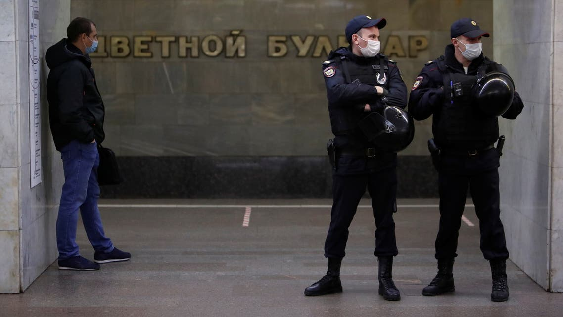 Police officers stand guard at Tsvetnoi Bulvar (Tsvetnoy Boulevard) metro station, as nationalists and activists of far-right political groups hold a rally near the station, on the National Unity Day in Moscow, Russia November 4, 2020. REUTERS/Maxim Shemetov