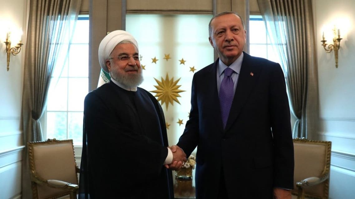 Turkish President Recep Tayyip Erdogan (R) and Iranian President Hassan Rouhani (L) shake hands before their meeting at the Presidential Palace in Ankara on September 16, 2019. (AFP)