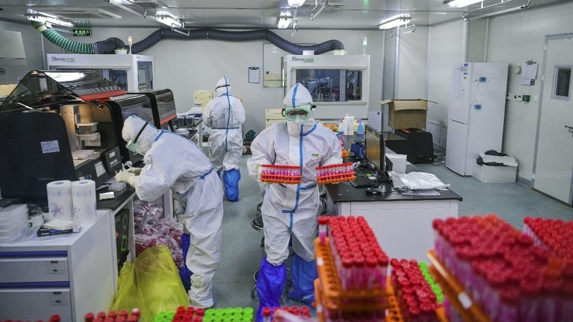 This photo taken on November 23, 2020 shows technicians processing Covid-19 coronavirus tests at a laboratory in Tianjin, China. (AFP)