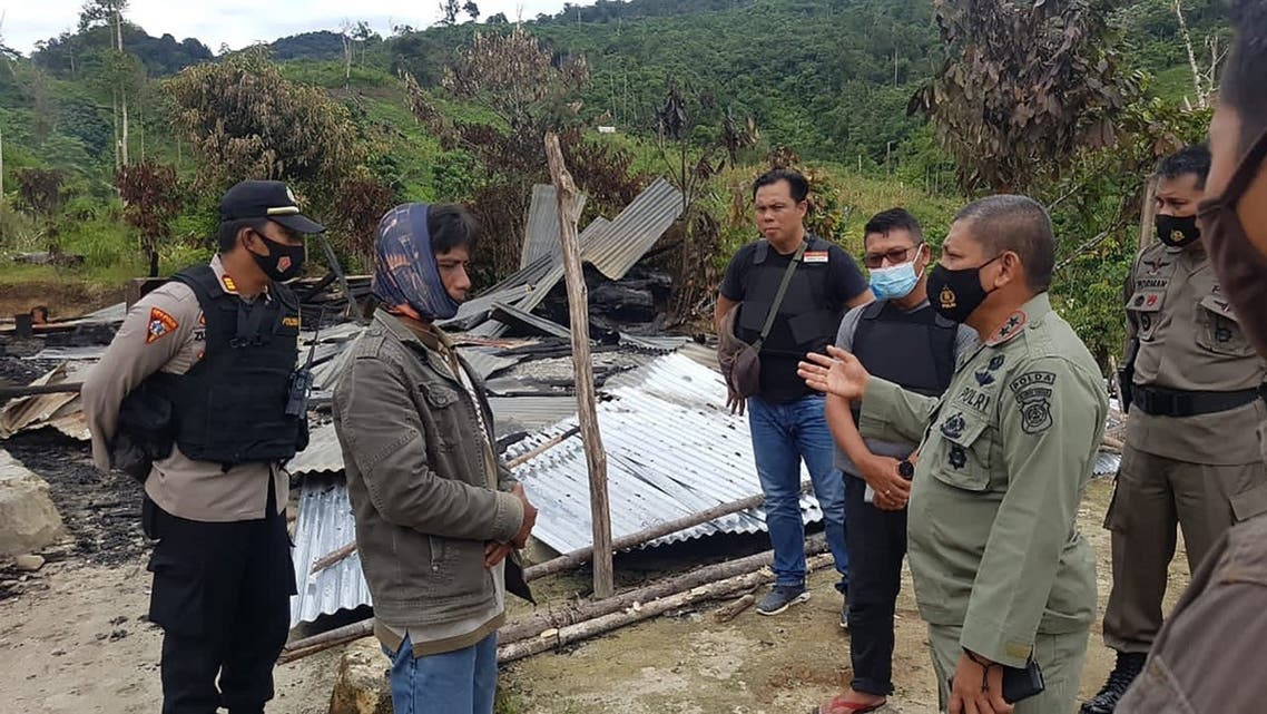 Police officers inspecting the site of an attack, believed to be by ISIS-linked extremists, that killed four people in a remote Christian community of Lembantongoa village, in Palu on the Indonesian island of Sulawesi. (Central Sulawesi Province Police/AFP)