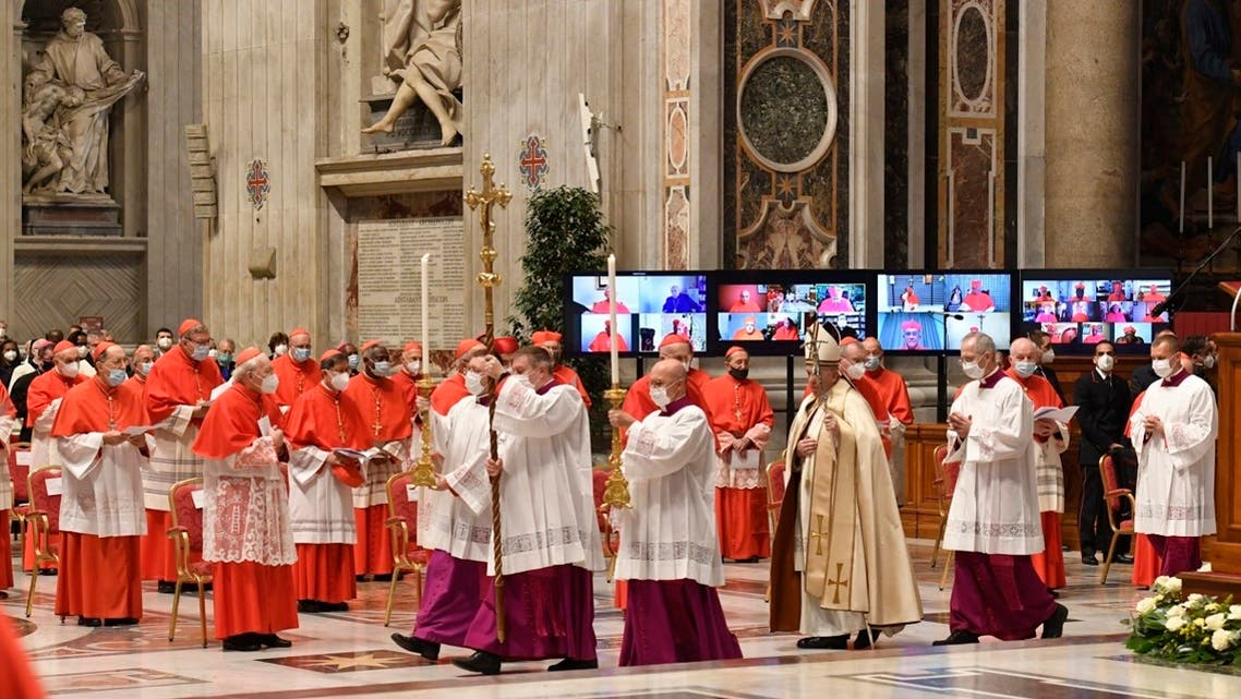 Pope Francis (3rdR) arriving for a consistory to create 13 new cardinals at St. Peter's Basilica in The Vatican. (Vatica Media/AFP)