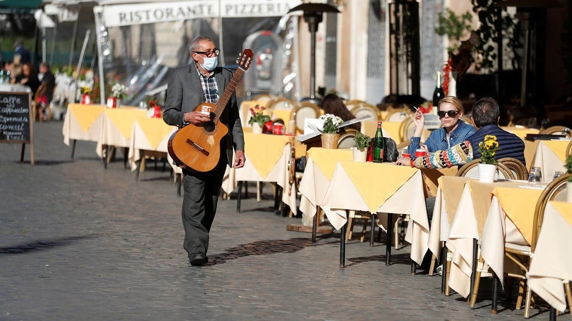 A musician walks in Piazza Navona square, as the spread of the coronavirus disease (COVID-19) continues, in Rome, Italy November 23, 2020. (Reuters/Yara Nardi)
