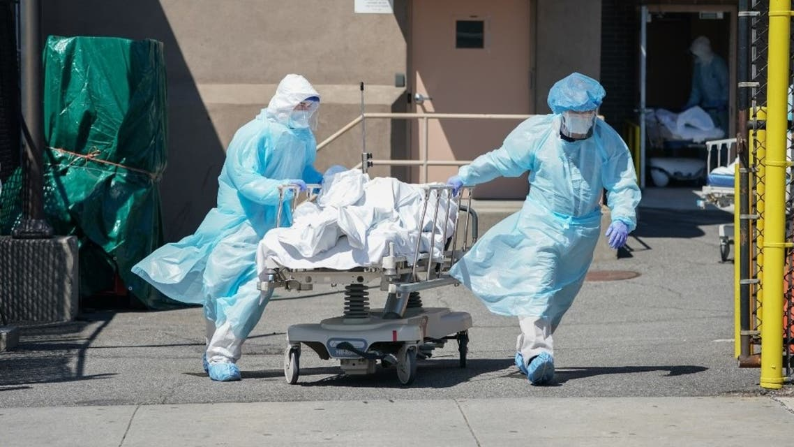 Bodies are moved to a refrigeration truck serving as a temporary morgue at Wyckoff Hospital in the Borough of Brooklyn on April 6, 2020 in New York. (AFP)