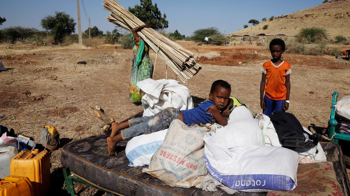 Ethiopian refugees sit on their belongings at the Um Rakuba refugee camp which houses Ethiopian refugees fleeing the fighting in the Tigray region, on the Sudan-Ethiopia border, Sudan, November 28, 2020. REUTERS/Baz Ratner