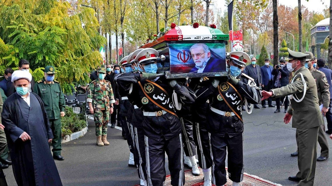 A handout picture provided by Iran's Defesce Ministry on November 30, 2020 shows members of Iranian forces carrying the coffin of slain top nuclear scientist Mohsen Fakhrizadeh during his funeral ceremony in Iran's capital Tehran. (AFP)