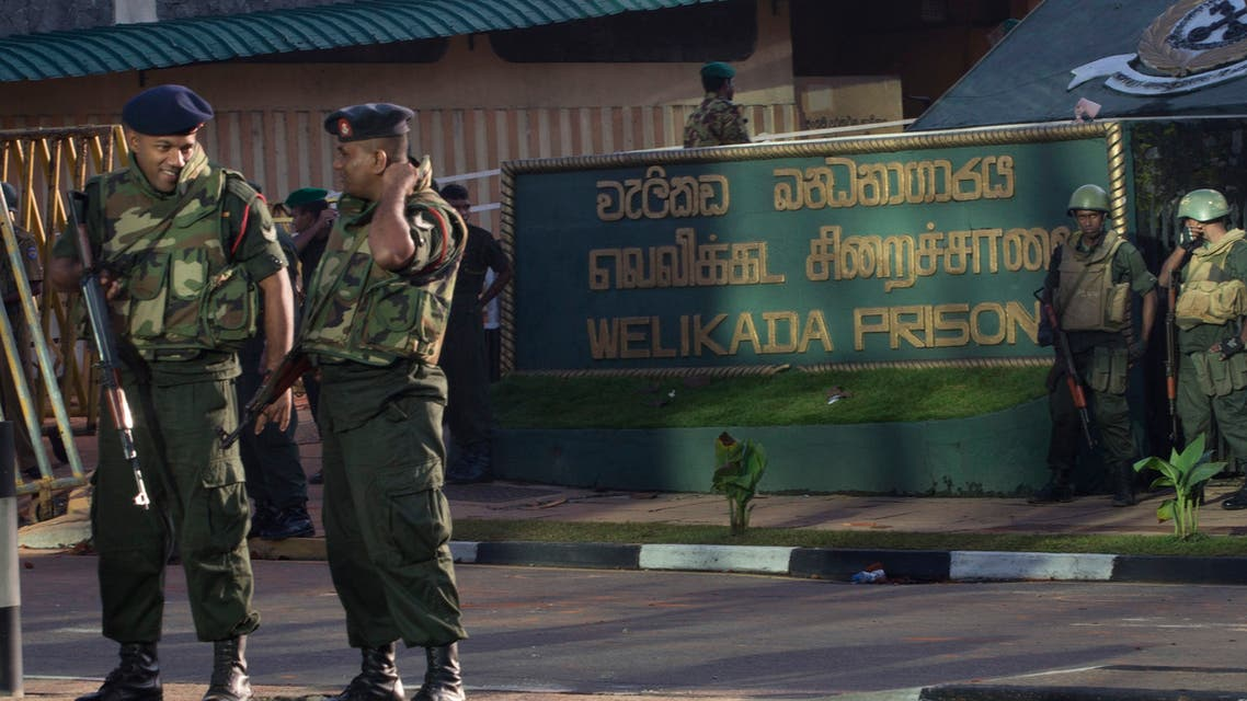 Army soldiers stand guard at the entrance of Welikada prison in Colombo, Sri Lanka, Saturday, Nov. 10, 2012. (AP)