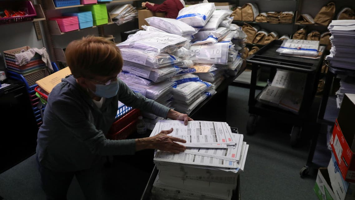 The election official Pam Hainault works in the ballot room organizing unused ballots returned from voting precincts after Election Day at the Kenosha Municipal Building in Kenosha, Wisconsin, U.S. November 4, 2020. REUTERS/Daniel Acker