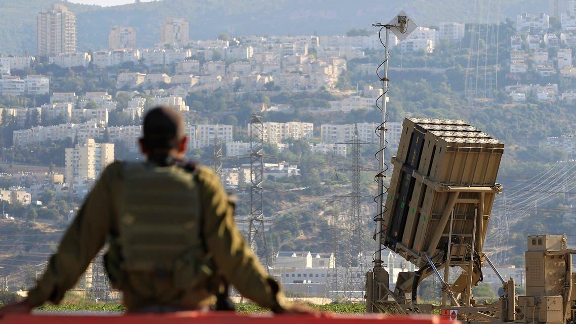 An Israeli soldier is seen next to an Iron Dome rocket interceptor battery deployed near the northern Israeli city of Haifa on Aug. 28, 2013. (AP)