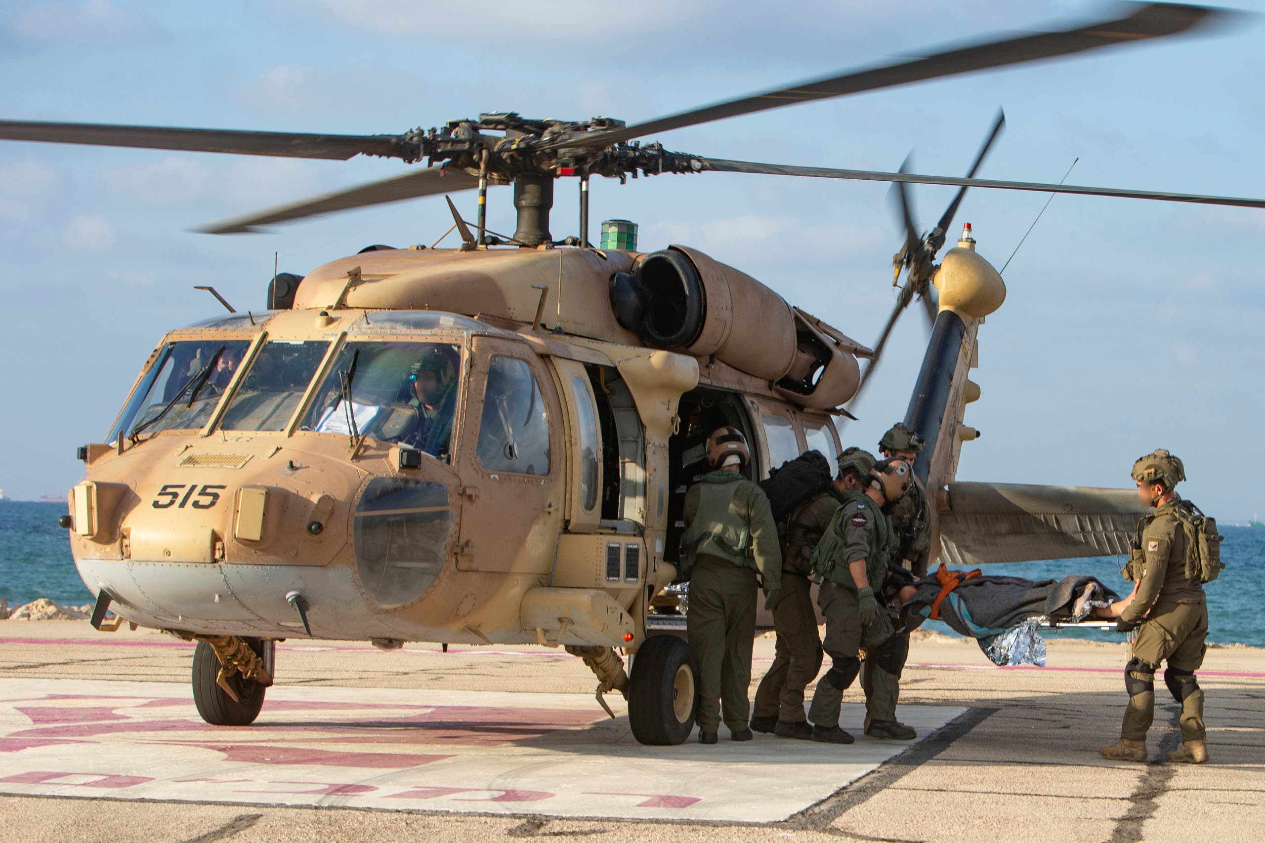 Israeli paramedics and soldiers evacuate a mock wounded comrade at a helipad in Ramban hospital in the Mediterranean city of Haifa on September 1, 2019 as part of a deception operation of the Israeli army in order to mislead the leadership of Lebanese Hezbollah. (File photo: AP)