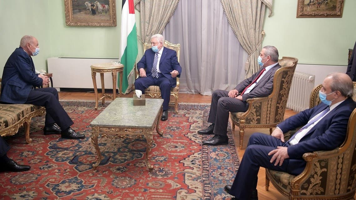 A handout picture provided by the Palestinian Authority's press office (PPO) on November 29, 2020 shows Palestinian president Mamhud Abbas (C) meeting with Arab League Secretary-General Ahmed Aboul Gheit (L) in Egypt's capital Cairo. (Thaer Ghanaim/AFP/PPO)