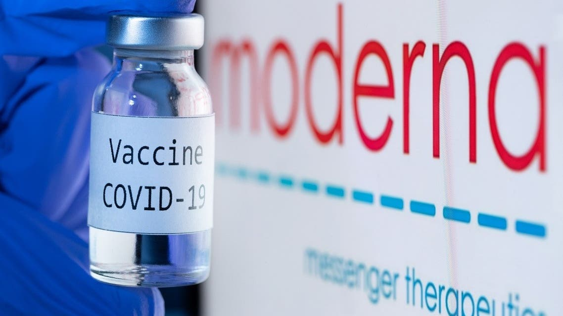 "In this file photo taken on November 18, 2020 shows a bottle reading ""Vaccine COVID-19"" next to the Moderna biotech company logo. (Joel Saget/AFP)"