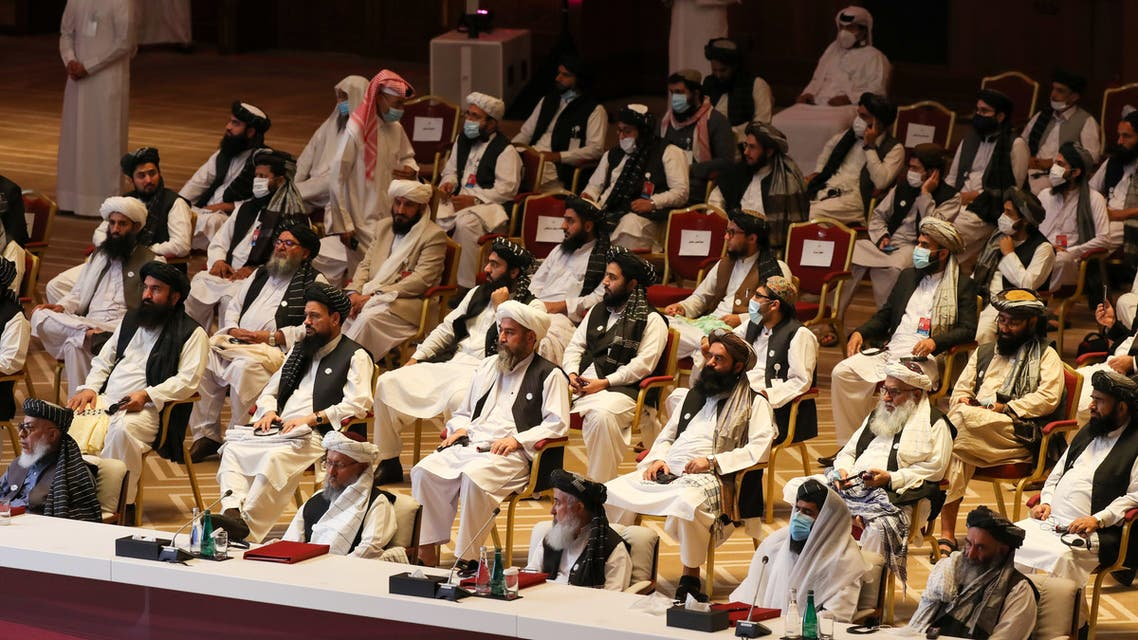 Members of the Taliban delegation attend the opening session of the peace talks between the Afghan government and the Taliban in the Qatari capital Doha on September 12, 2020.