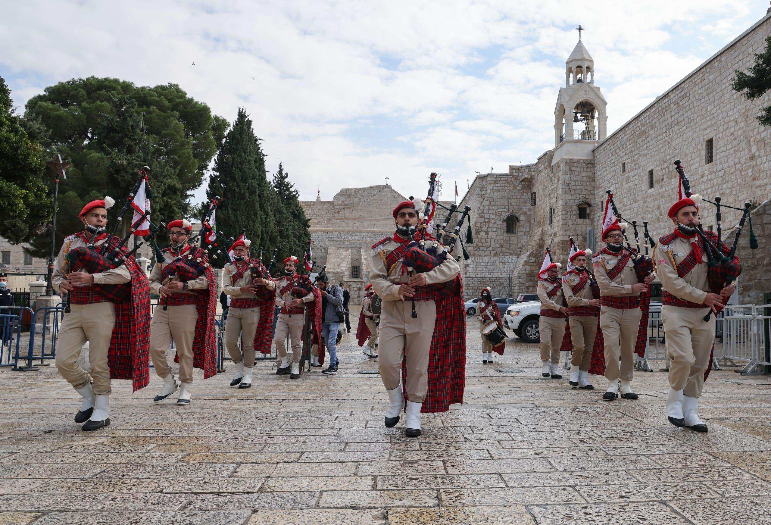 A procession to celebrate a mass at the Church of the Nativity compound in Bethlehem on November 28, 2020. (AFP)