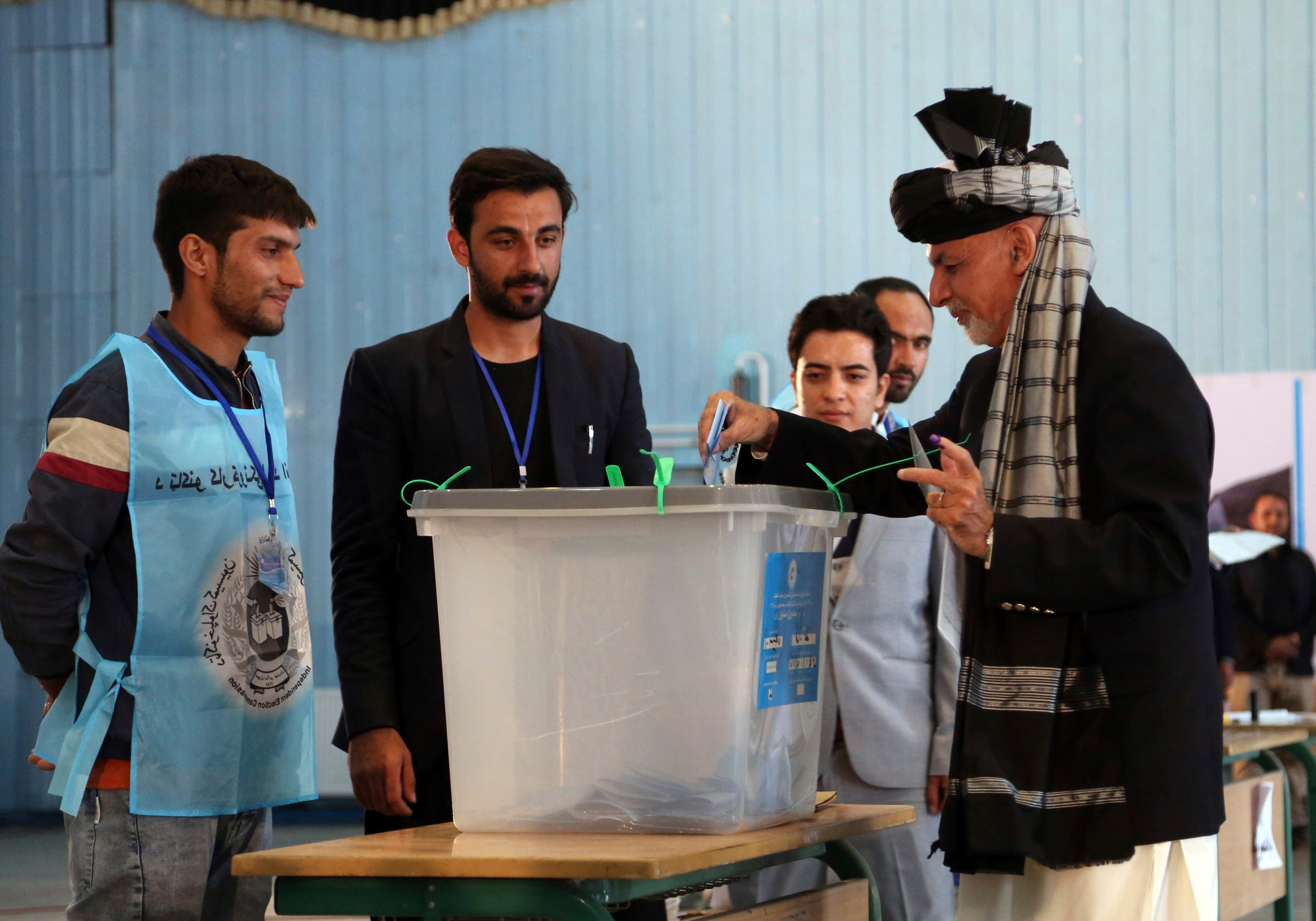 Afghan President Ashraf Ghani, right, casts his vote at Amani high school, near the presidential palace in Kabul, Afghanistan, Saturday, Sept. 28, 2019. Afghans headed to the polls on Saturday to elect a new president amid high security and Taliban threats to disrupt the elections, with the rebels warning citizens to stay home or risk being hurt. (AP Photo/Rahmat Gul)
