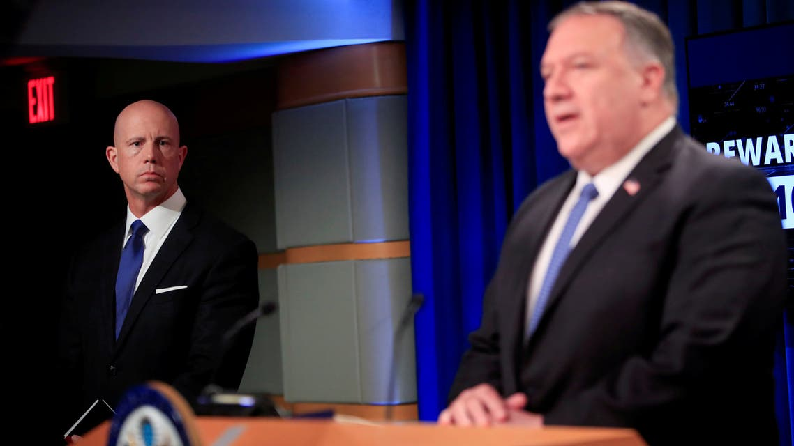 U.S. State Department Deputy Spokesperson Cale Brown listens as U.S. Secretary of State Mike Pompeo speaks during a news conference at the State Department in Washington, U.S. August 5, 2020. Pablo Martinez Monsivais/Pool via Reuters