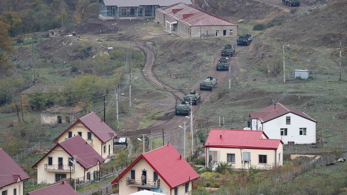 Armoured personnel carriers of the Russian peacekeeping forces drive along a road in a settlement near Lachin in the region of Nagorno-Karabakh, November 13, 2020. REUTERS/Stringer