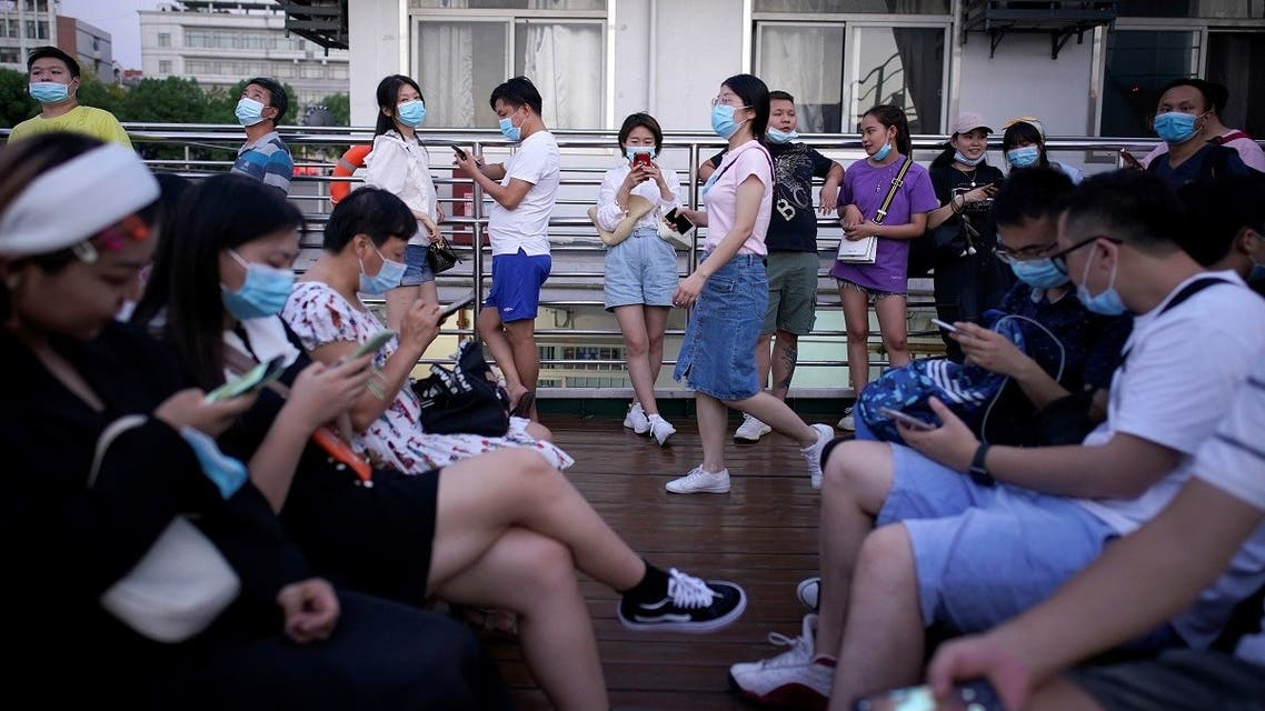 People use mobile phones on a boat sailing on Yangtze River following the coronavirus disease (COVID-19) outbreak, in Wuhan, Hubei province, China, September 3, 2020. (Reuters/Aly Song)