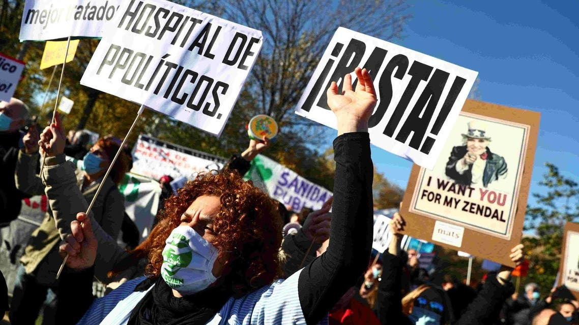 Health workers protest outside the Enfermera Isabel Zendal new hospital during its inauguration in Madrid. (File photo: Reuters)
