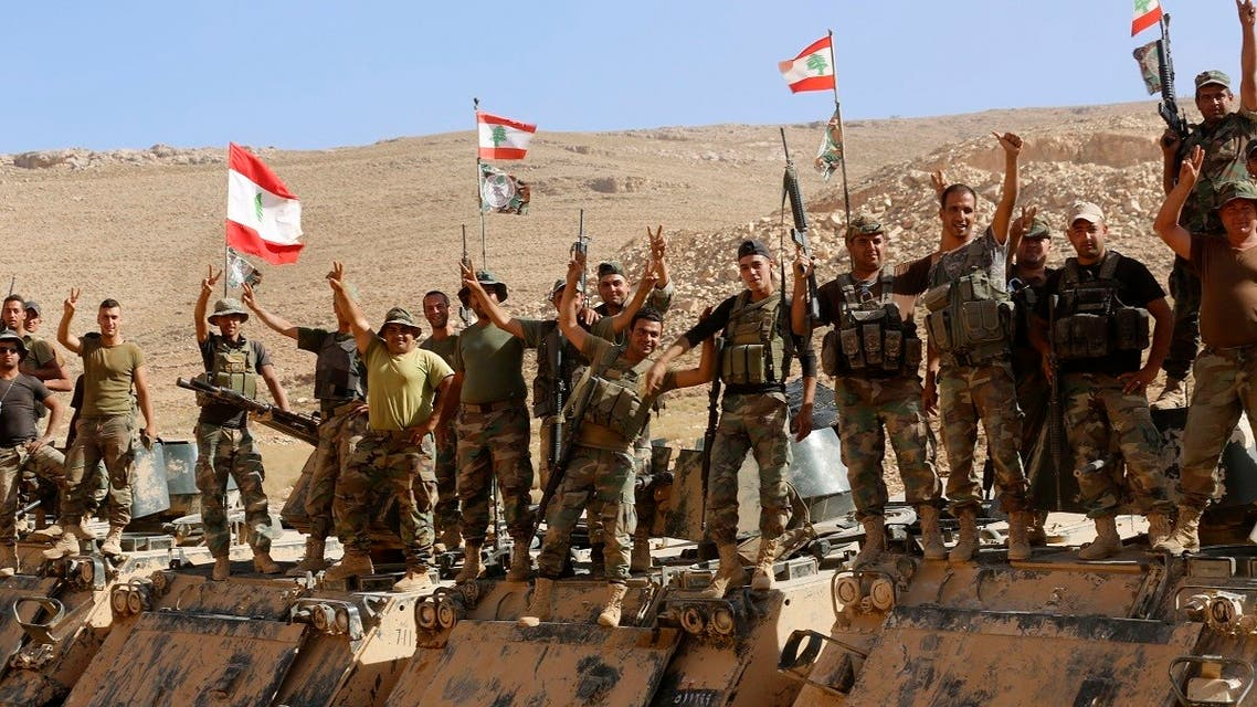 Lebanese army soldiers flash victory signs as they rest on top of an armoured personnel carrier in northeast Lebanon, Aug. 28, 2017. (AP)