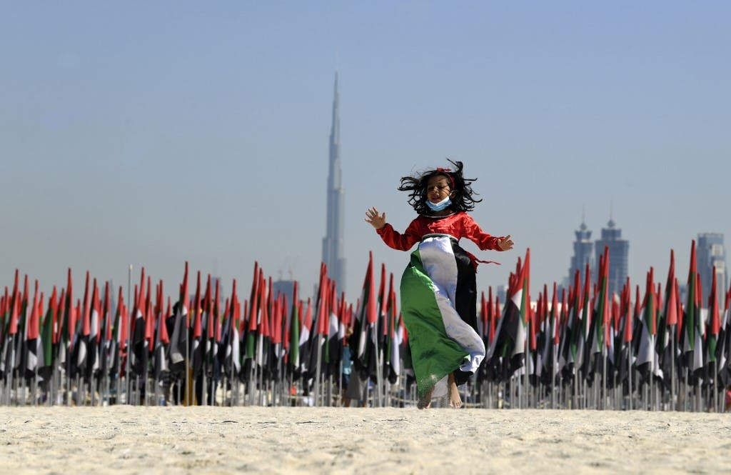 Emiratis attend celebrations of UAE's national day on December 2, 2020. (AFP)