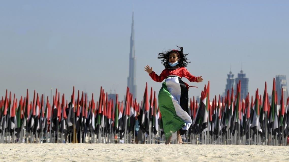 Emiratis attend celebrations of UAE's national day on December 2, 2020. Karim SAHIB / AFP