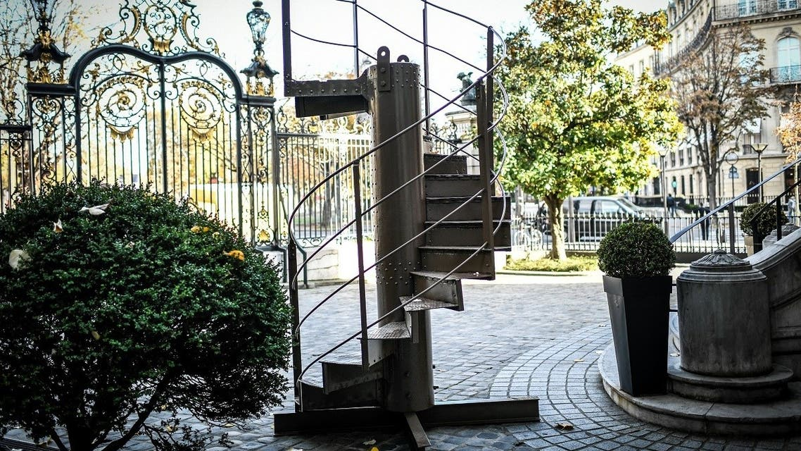 In this file photo taken on November 12, 2020 shows a section of the original Eiffel Tower's stairs, displayed in front of the Artcurial auction house in Paris. (Stephane De Sakutin/AFP)