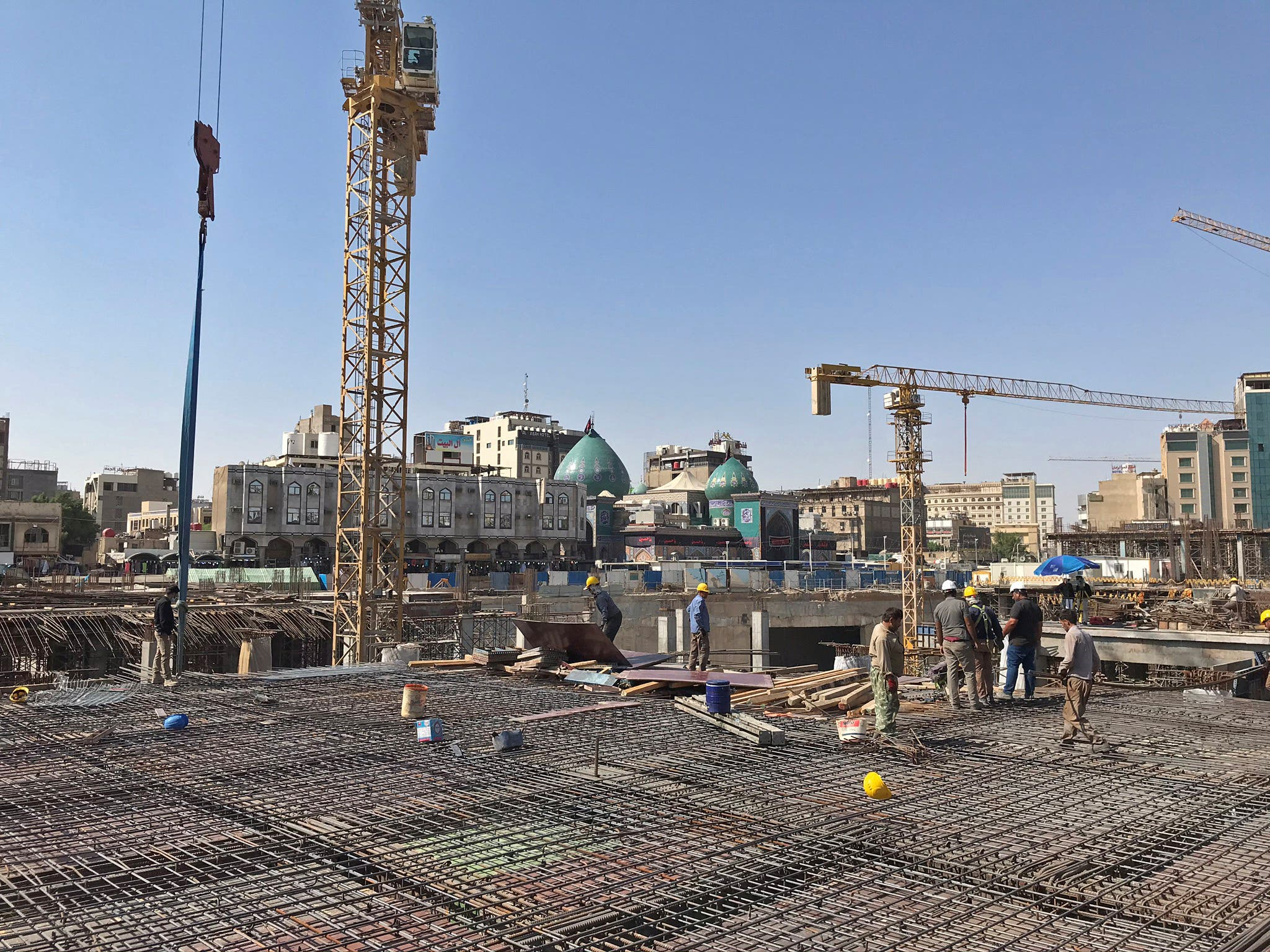 Iranian laborers and engineers work on the Sahn al-Aqila project, a vast expansion to the area adjacent to the Imam Hussein shrine that will be used to welcome mostly Shi'ite Muslim pilgrims in Kerbala, Iraq September 30, 2020. (Reuters)