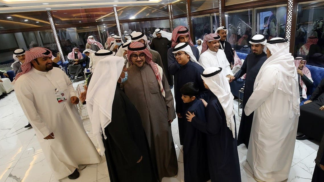 Kuwaitis attend an electoral campaign meeting ahead of the upcoming election scheduled for later in the week, in Kuwait City on December 2, 2020. (AFP)