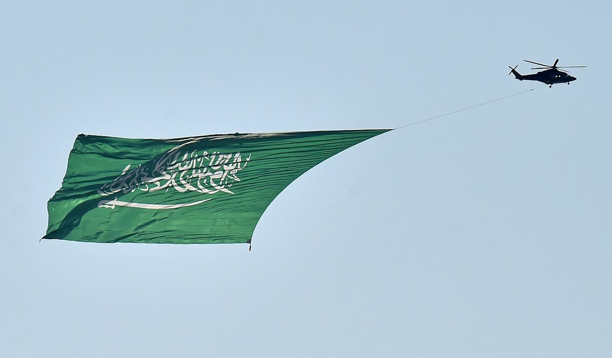 A military helicopter flies over Riyadh during celebrations marking Saudi Arabi's 90th National Day, Sept. 23, 2020. (AFP)