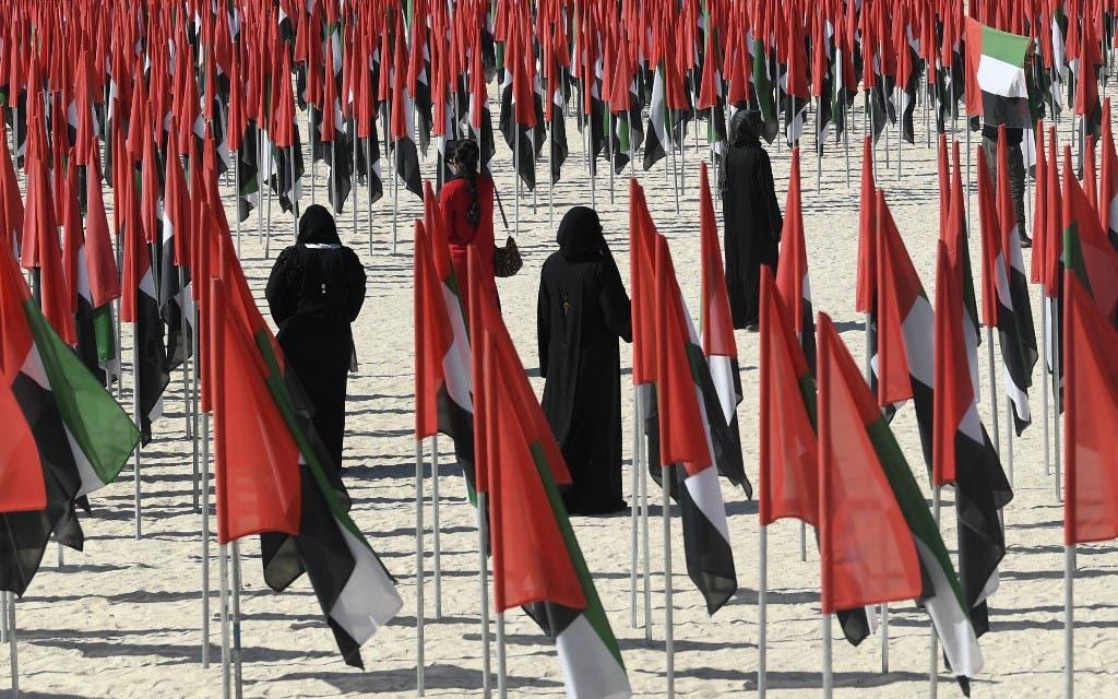 Emiratis attend celebrations of UAE's national day on December 2, 2020. (Karim Sahib/AFP)