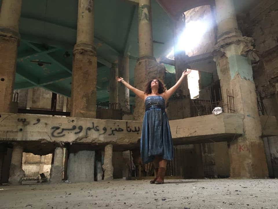 A still of Mona Hallab singing at the Grand Theatre during the Oct. 17 protests, filmed by Marie-Rose Osta. (Screengrab)