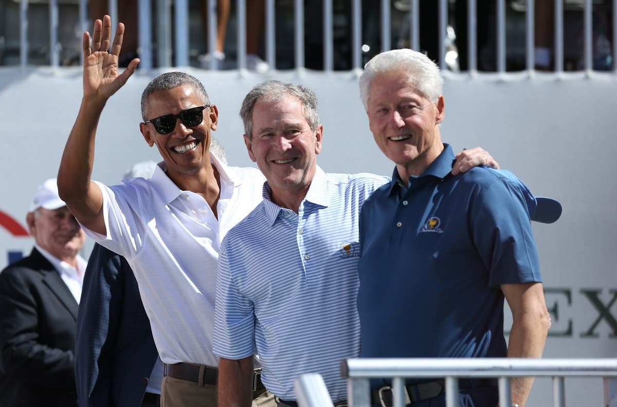 Former U.S. Presidents (from Left) Barack Obama and George W. Bush and Bill Clinton smile during the first round foursomes match of The President's Cup golf tournament at Liberty National Golf Course. (Bill Streicher-USA TODAY Sports)