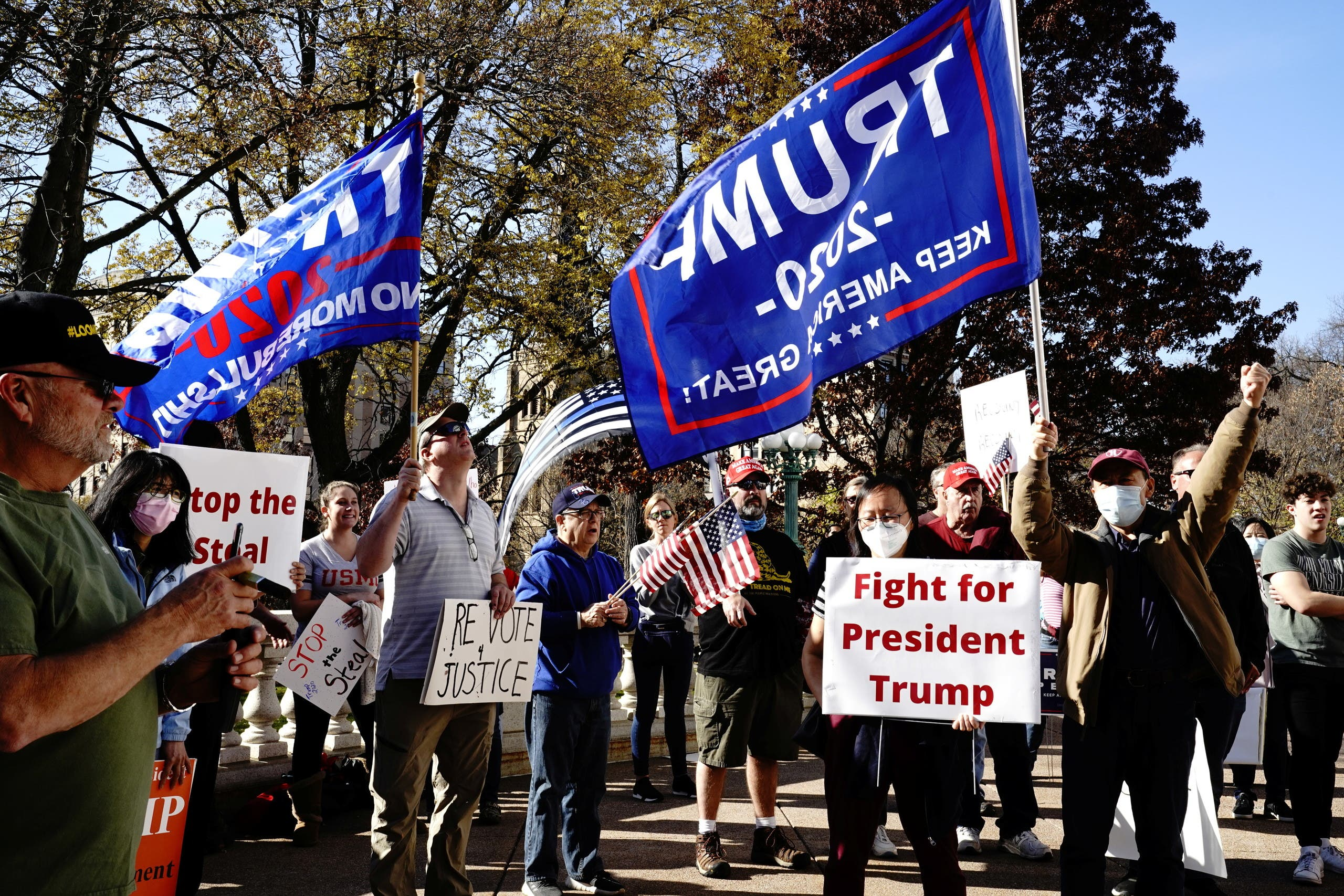 Supporters of President Donald Trump attend a 'Stop the Steal' protest outside the Wisconsin State Capitol in Madison, Wisconsin, U.S., November 7, 2020. (Reuters)