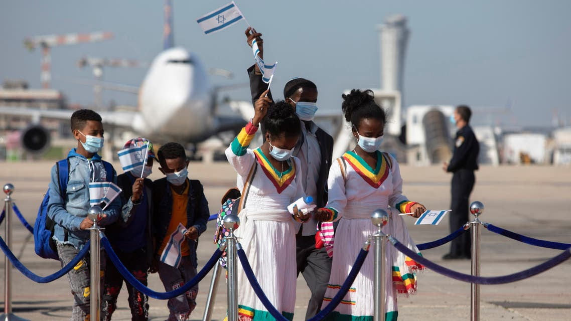 Ethiopian immigrants arrive at the Ben Gurion airport on Dec. 3, 2020. (AP)