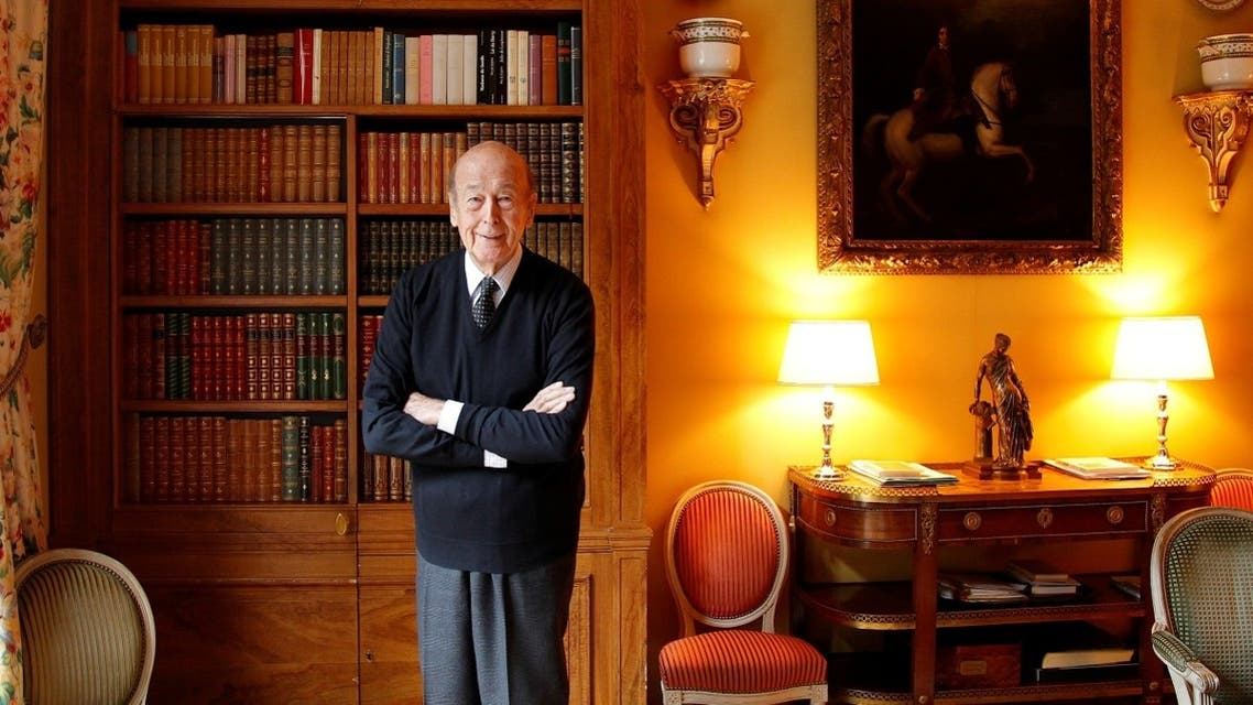 Former French President Valery Giscard d'Estaing poses for a portrait in his office at his home in Paris. (Reuters)