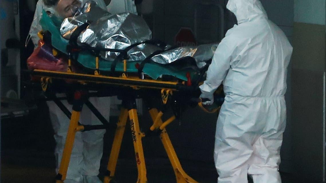 Paramedics transport a COVID-19 patient at a hospital in Warsaw, Poland December 3, 2020. REUTERS/Kacper Pempel