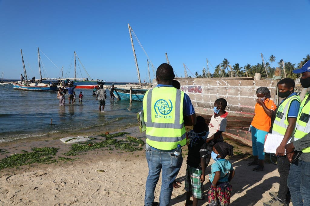 This handout picture taken on November 6, 2020 in Pemba, northern Mozambique, by IOM (International Organization for Migration) shows internally displaced people being assisted by the IOM Displacement Tracking Matrix (DTM) team. (Sandra Black/IOM/AFP)