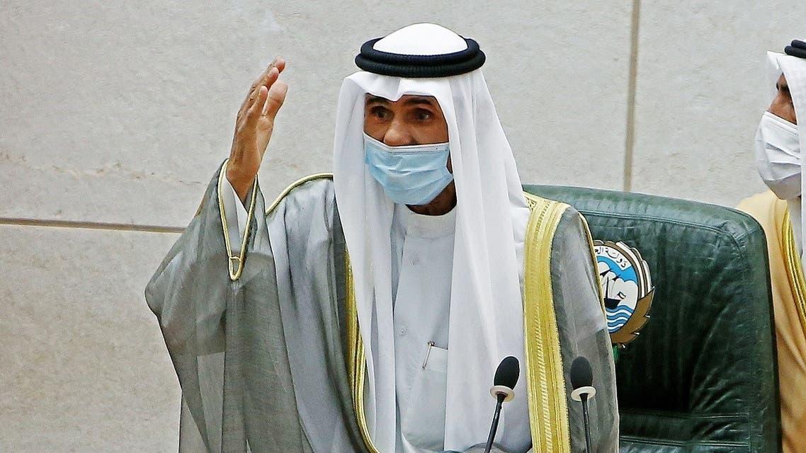 Emir of Kuwait Sheikh Nawaf al-Ahmad al-Jaber al-Sabah gestures during a parliament session. (AFP)