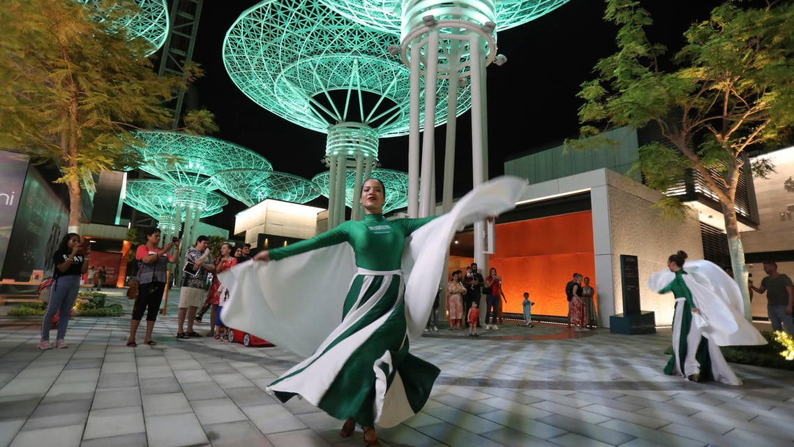 Women in Saudi National flag colours and logo outfit, perform during Saudi National Day celebrations at the Bluewaters Island in Dubai, United Arab Emirates, Friday, Sept. 20, 2019. (AP)
