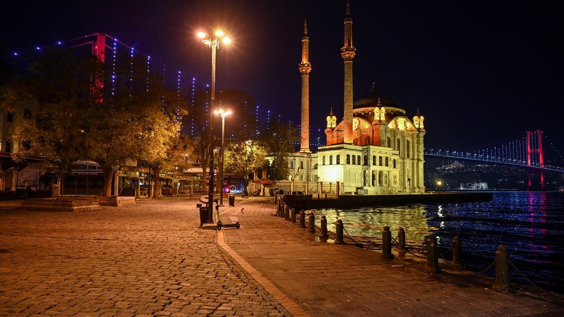 General view of the deserted Ortakoy square, during a night-time curfew aimed at curbing the spread of the Covid-19 pandemic caused by the novel coronavirus, in Istanbul, on November 28, 2020. A partial curfew from 8pm to 10am started in Turkey on November 28, 2020. People under 20 and over 65 will be allowed out during specific hours on weekdays while cafes and restaurants will be closed on weekends.