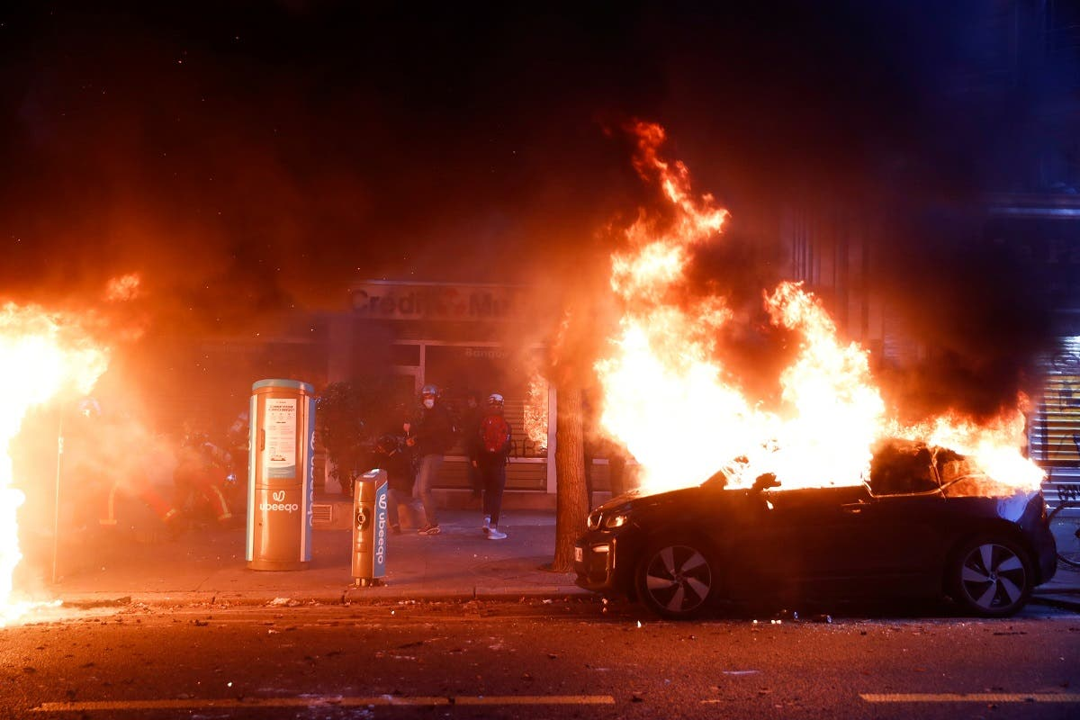 A car burns during a protest against the Global Security Bill'', that right groups say would make it a crime to circulate an image of a police officer's face and would infringe journalists' freedom in the country, in Paris. (Reuters)