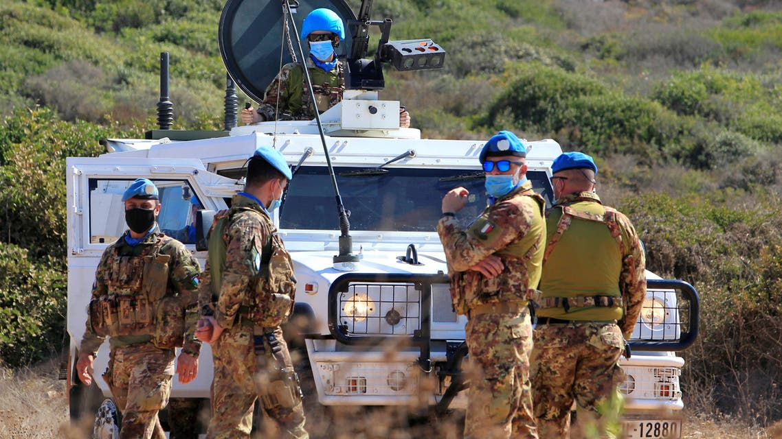 UN peacekeepers (UNIFIL) stand near a UN vehicle in Naqoura, near the Lebanese-Israeli border, southern Lebanon October 14, 2020. REUTERS/Aziz Taher