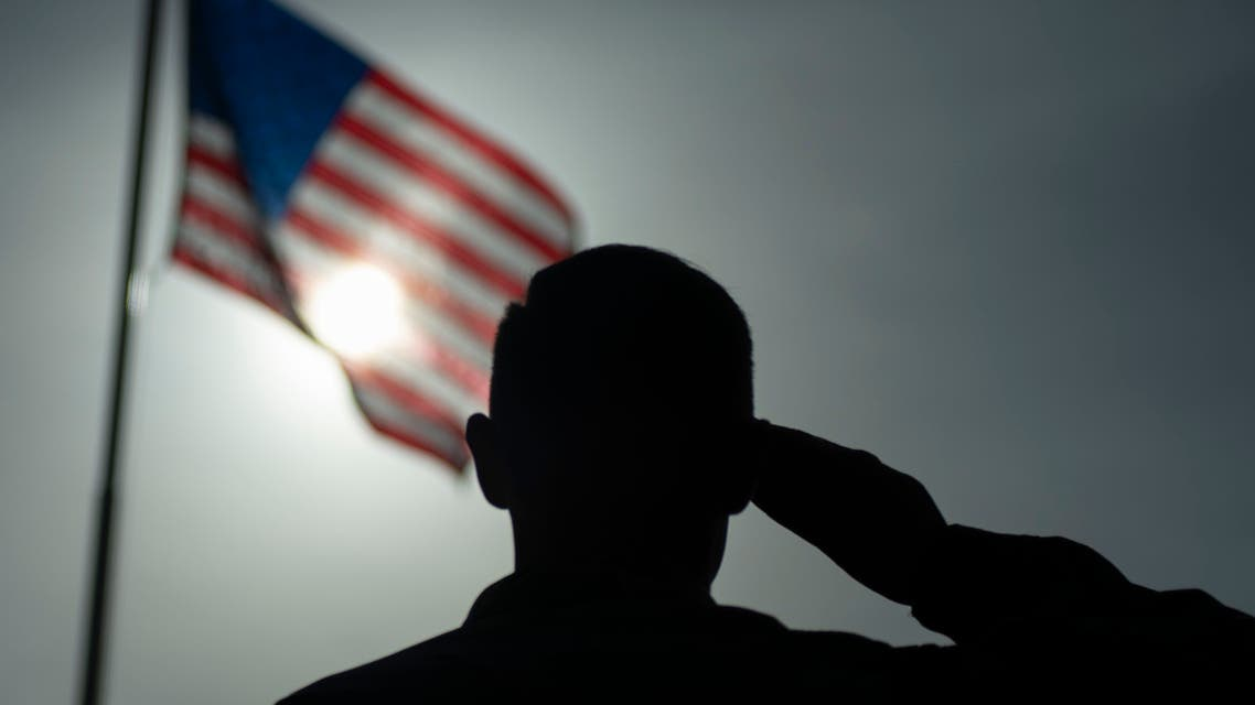 This US Air Force file photo obtained January 5, 2020 shows US Air Force Staff Sgt. Devin Boyer, 435th Air Expeditionary Wing photojournalist, as he salutes the flag at Camp Simba, Kenya, on August 26, 2019. Jihadists from Somalia's Al-Shabaab group on January 5, 2020 stormed a military base used by US forces in Kenya's coastal Lamu region, killing three American citizens and destroying several aircraft and military vehicles, officials said. Attackers breached heavy security at Camp Simba at dawn but were pushed back and four jihadists killed, said army spokesman Colonel Paul Njuguna. The American military, however, said three US citizens died in the attack including a service member and two civilian defence contractors.
