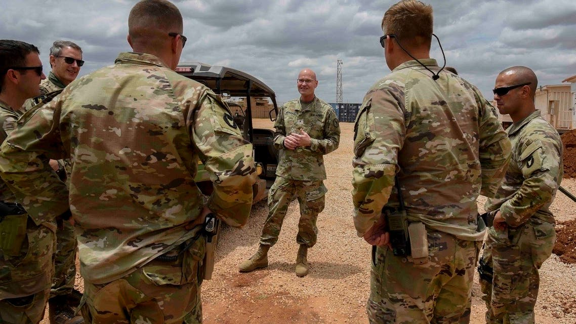 U.S. Army Brig. Gen. Damian T. Donahoe talks with service members during a battlefield circulation in Somalia. (AP)