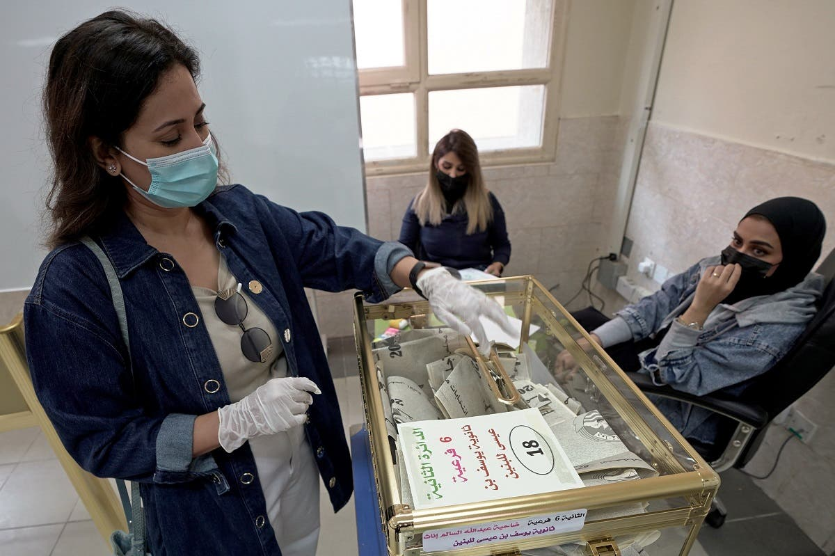 A Kuwaiti woman casts her vote at a polling station during parliamentary elections in Jahra City, Kuwait. (Reuters)