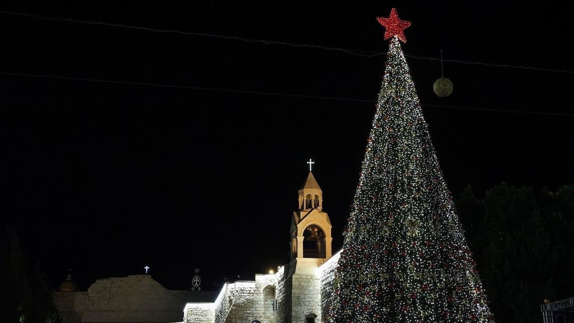 A picture taken on December 5, 2020, shows the Christmas tree after a lighting ceremony in the biblical city of Bethlehem in the occupied West Bank. (Reuters)