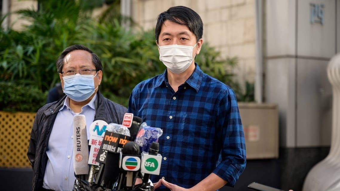 Former lawmaker from Hong Kong's pro-democracy opposition Ted Hui (R), accompanied by veteran pro-democracy politician Albert Ho (L), speaks to the media as he leaves the Western Police Station in Hong Kong, November 18, 2020. (Anthony Wallace/AFP)